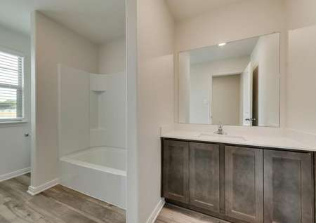 The secondary bath has a great vanity and shower/tub combo.