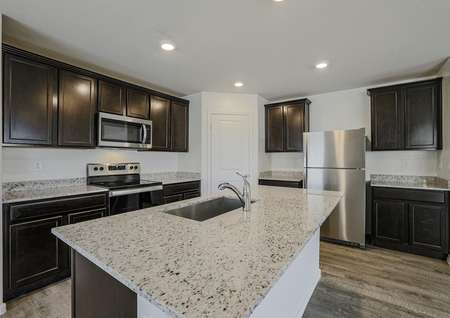 Stunning kitchen with stainless appliances and granite countertops.