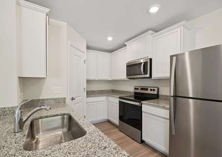 The kitchen of the Chatfield includes high-grade white cabinetry, gray granite counters, stainless appliances, recessed lighting and plank flooring.