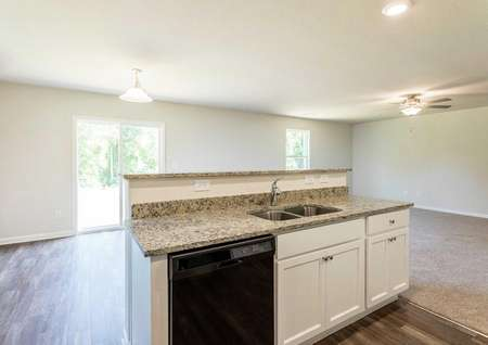 Avery home picture of granite kitchen island and great room with carpeted floor