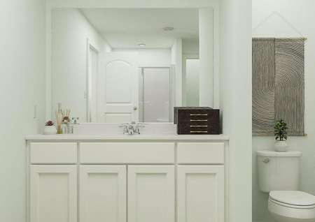 Rendering of owners bathroom with white   finishes, mirror above sink and toilet to the side.