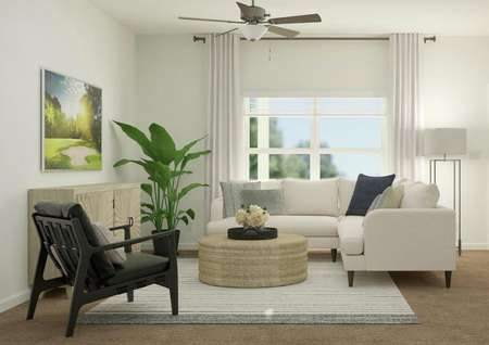 Rendering of the living room, which has   carpeted flooring and a large window. The space is furnished with a   sectional, round coffee table and accent chair.