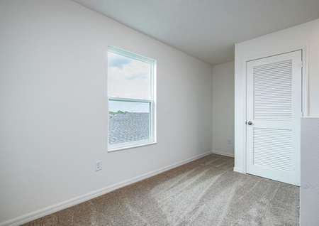 The upstairs bonus loft is large enough to be transformed into a home office or game room.