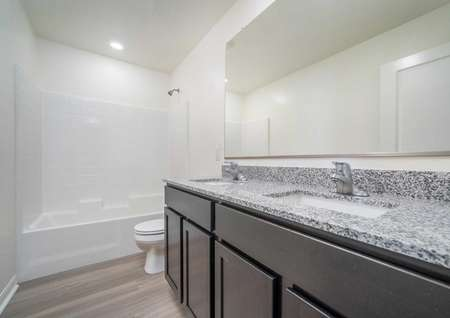 Redondo bathroom with granite counters, under mounted sink, large glass mirror