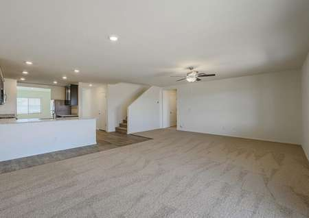 Extra spacious family room, giving you all the room you need to lounge comfortably, with access to the kitchen.