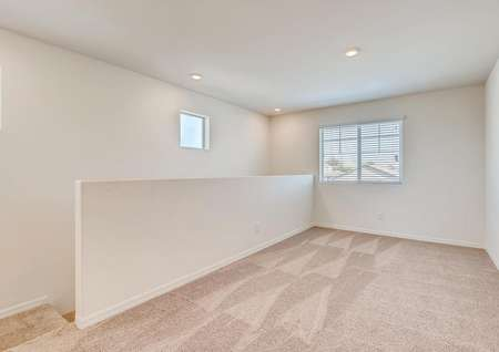 Carpeted, upstairs bonus loft with a window overlooking the front yard.