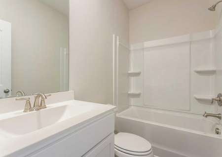 Burton guest bath with white fixtures, bathtub/shower combo, and modern sink