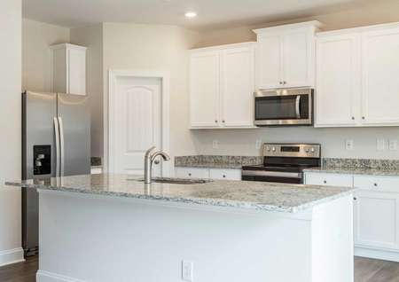 Hartford kitchen with granite countertops, stainless steel appliances, and white cabinets