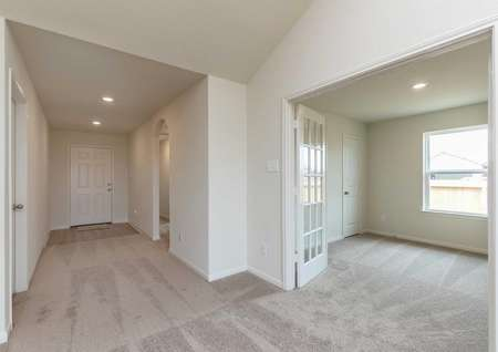 Sabine new home plan with carpeted floors, French doors, and white trim on off-white walls