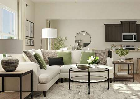 Rendering of living room focused on white   sectional couch, round glass table and two side tables with dining and   kitchen areas in the background