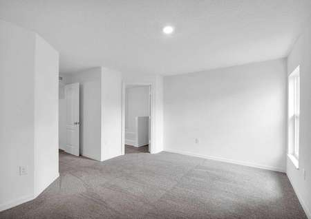 Sizable master bedroom with a large window and a full bathroom.