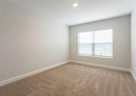 Hartford bedroom with large front-facing window, off white finished walls, and brown carpet