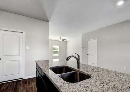 Carson kitchen completed with granite counters, wood cabinets, and white paint trim on gray walls