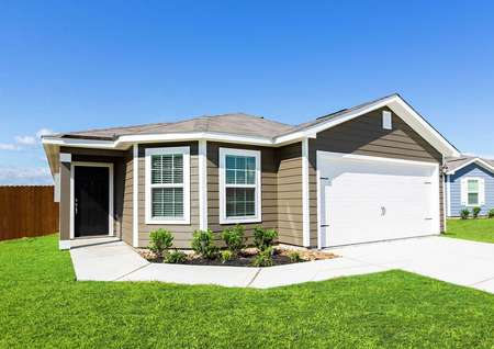 Pecos finished model with brown siding, white trim and garage door, and landscaped yard