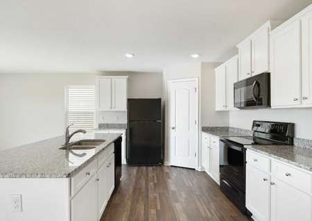 Avery finished kitchen with black appliances, wood-tiled floors, and grey granite countertops