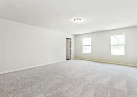Lincoln master bedroom with two large windows, gray painted walls with white trim, and gray carpeting