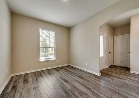 Ozark dining room with ceiling light, wood-look vinyl floors, and white trim on off white walls