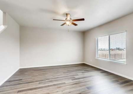 Mesa Verde living room with brown ceiling fan, wood like floors, and grey walls with white trim