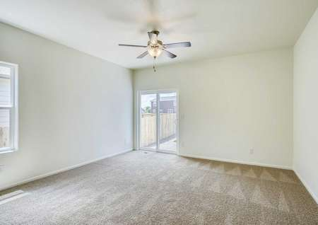 Arapaho living room with carpeting, ceiling fan, and white sliding patio door
