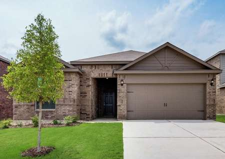 The Reed plan has a brick and siding exterior, professional front yard landscaping and an attached two-car garage.