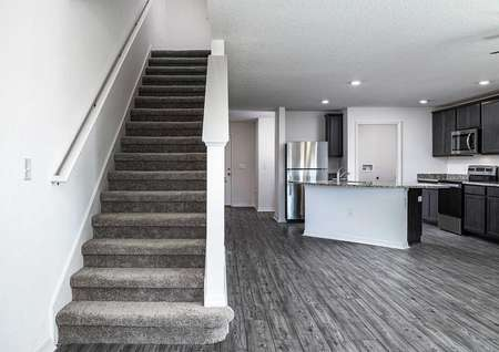 Grand entertainment space next to stairs leading to the second floor's bedrooms.