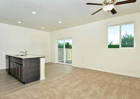 New great room with recessed lights, carpet flooring, and brown cabinets