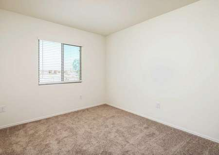 The Alamo floor plan second bedroom offers another view of carpeted bedroom with single window.