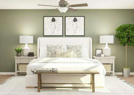 Rendering of the   spacious master bedroom in the Conway. The room has a green accent wall,   ceiling fan and carpeted flooring. It is furnished with a large bed with a   wooden bench at the foot of it and two nightstands.