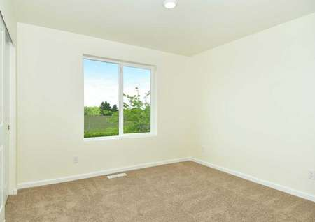 Hawthorn bedroom with light color carpets, floor vents, and white trim