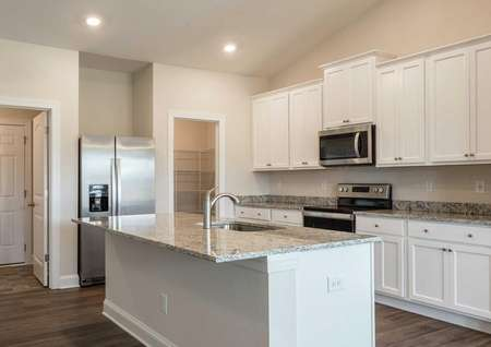 Burton kitchen with island sink, modern appliances, and white finish cabinetry