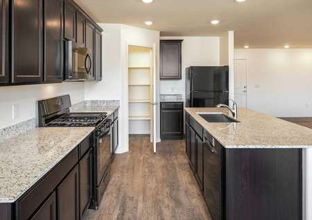 The Roosevelt floor plan showing side view of the kitchen with granite countertops and dark brown cabinets.