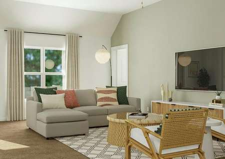 Rendering of living room with large   couch, additional seating, window behind couch, and tv to the side.