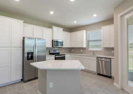 The Tuscany kitchen floor plan has stainless steel appliances, an island and quartz countertops.