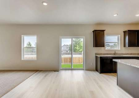 Columbia house great room with carpet family room, tiled kitchen/dining area, and patio doors to backyard