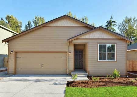 Columbia finished single story home with brown siding, dark brown trim, and landscaped front yard