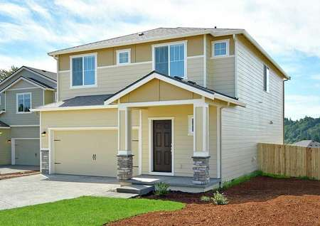 The Northwest Oak has great curb appeal with landscaped lawn white accent trim.