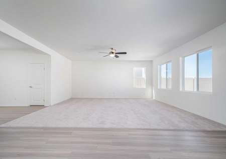 Redondo great room with carpet in the family room, hardwood floors in the dining room, and white trimmed walls