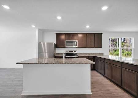 Full view of the home's kitchen which features all new kitchen appliances and granite countertops.