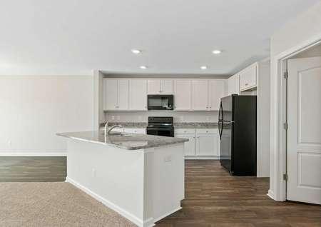 Allatoona kitchen with white cabinetry, granite countertops, and black appliances