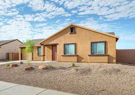 The Alamo single story home with desert landscape.
