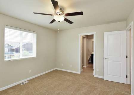 The Northwest Chelan master bedroom is carpeted with ceiling fan and attached in suite master bathroom.