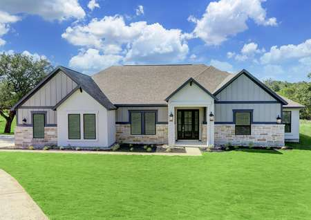 This beautiful home has an exquisite stone, siding and stucco exterior.