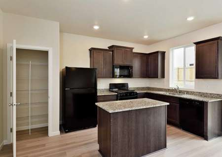 Cypress kitchen with custom cabinets, granite finish countertops, and wood style floors