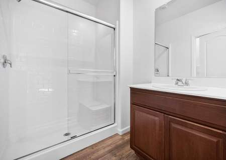 Spacious master bath with large, extended shower.