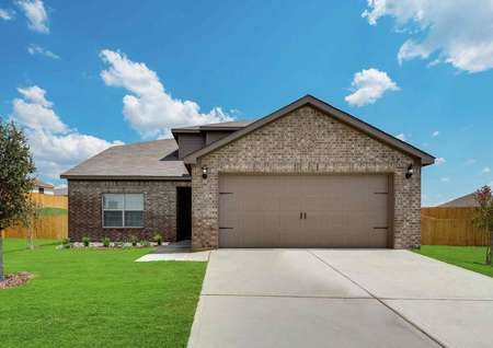 Cypress brick-finished house exterior with concrete driveway, two-car garage, and single story
