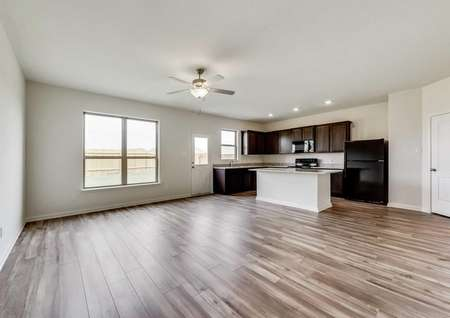 Jaguar kitchen and nook with brown cabinets, ceiling fan, and light color wood looking tile floors