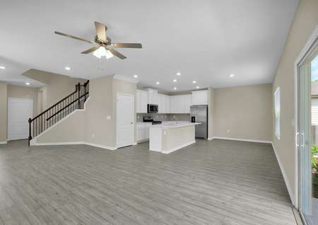 The home's family room overlooks the chef-ready kitchen and entrance stairs.