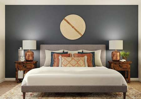 Rendering of the spacious master bedroom   with window on the left, and a large gray bed with nightstands against a dark   blue accent wall.