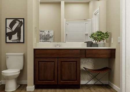 Rendering of the   master bath in the Allatoona showcasing a large vanity with brown cabinetry   and a white toilet. The dresser of the bedroom is visible through the open   door.