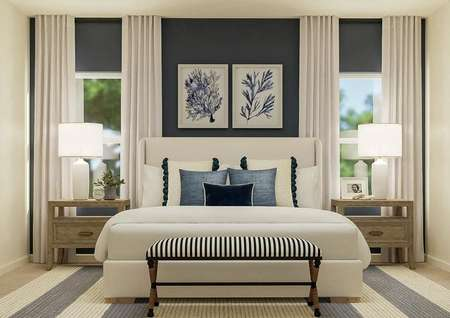Rendering of the spacious master bedroom   featuring a large bed centered between two windows. The room is also   furnished with two nightstands, a bench at the end of the bed and a   blue-and-white striped rug.